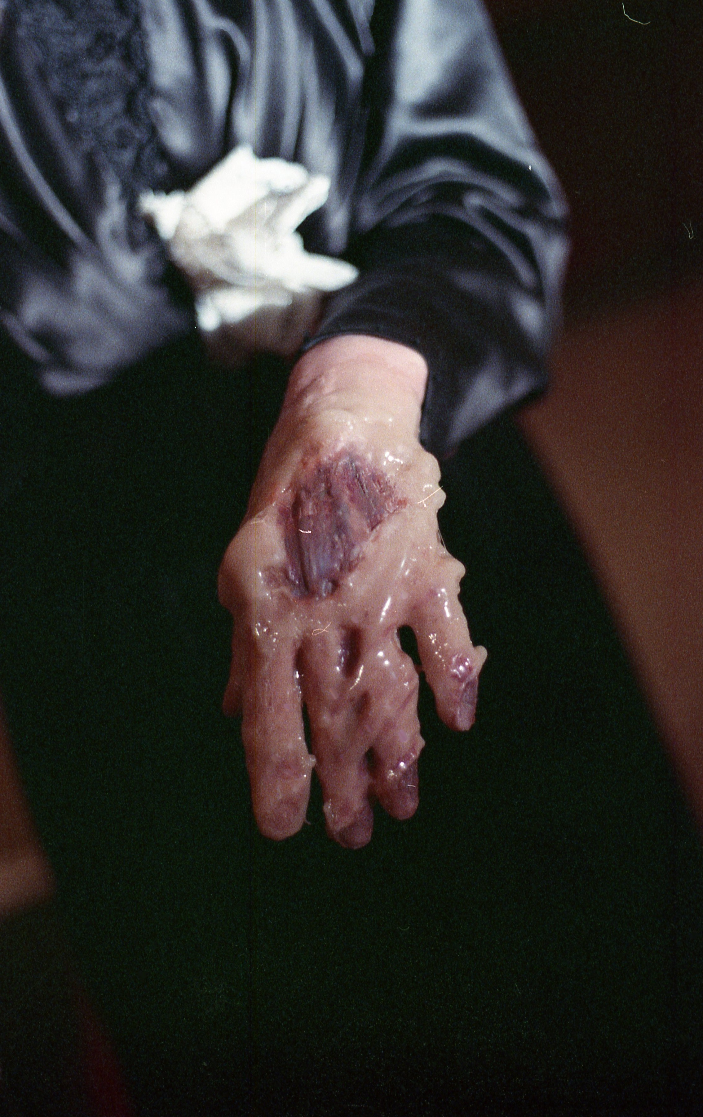 melting wax hand